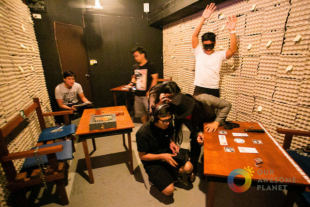 Group of men in an escape room.